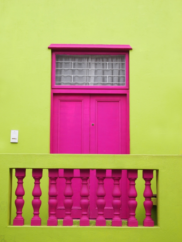Wall. Door to balcony. Bright colors. Deep pink and yellow-green