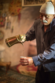 Druze man pouring coffee