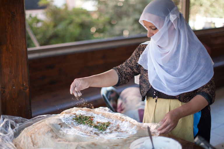 Druze woman making bread