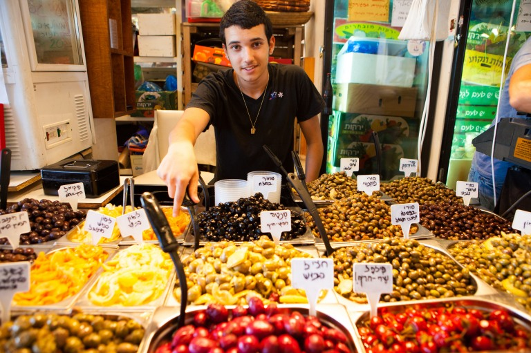 man selling pickled olives