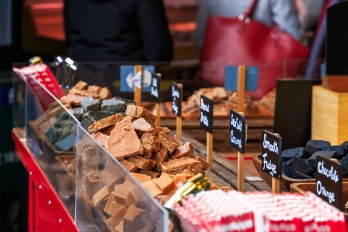 Sea salt caramel, fudge and other sweet on display on a confectionery stall at Borough Market in London