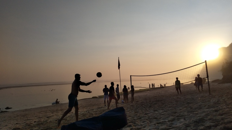 Enjoy a game of beach volleyball at sunset time
